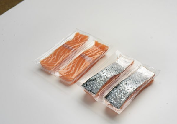 Salmon and Trout in portion in vaccum package